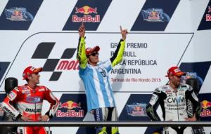 Rossi of Italy celebrates at the podium next to Dovizioso and Crutchlow after he won Argentina's MotoGP Grand Prix in Termas de Rio Hondo